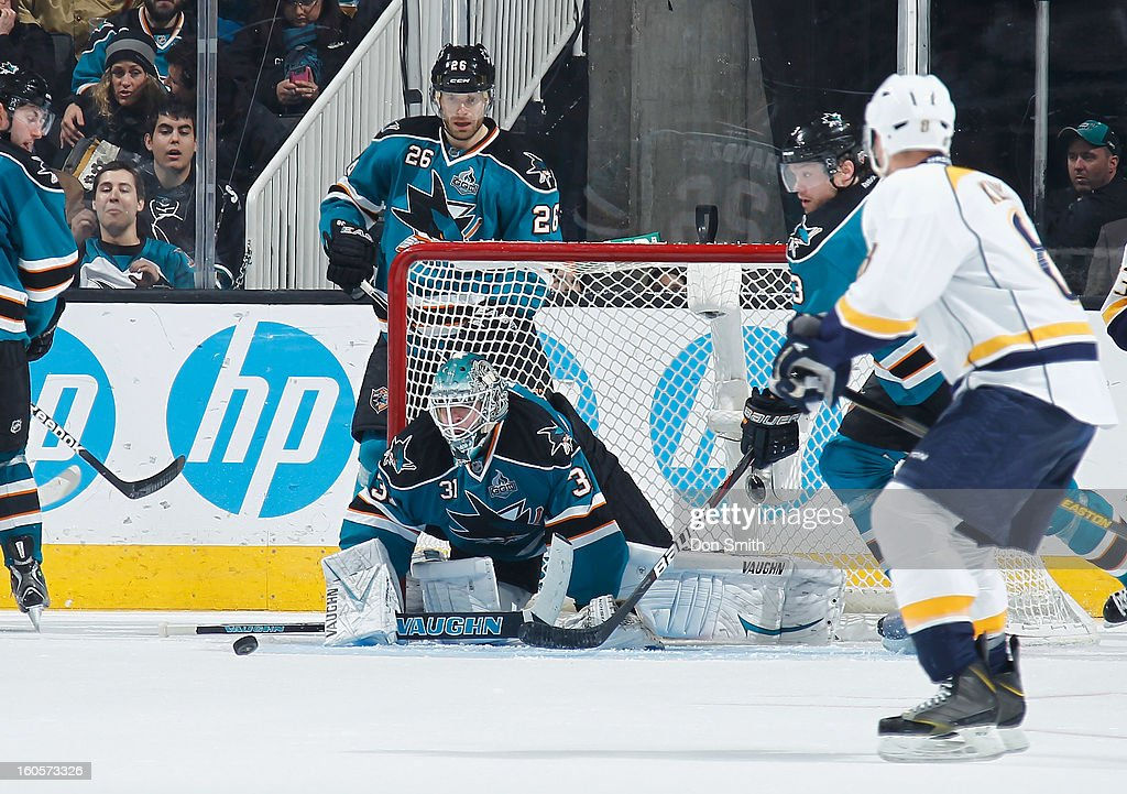 Antti Niemi #31, Michal Handzus #26 and Douglas Murray #3 of the San Jose Sharks defend the net against the Nashville Predators during an NHL game on February 2, 2013 at HP Pavilion in San Jose, California.