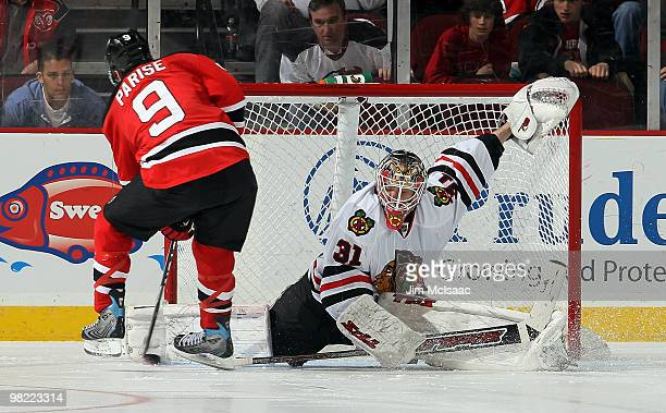 Antti Niemi of the Chicago Blackhawks makes a pad save against Zach Parise of the New Jersey Devils during the shootout at the Prudential Center on...