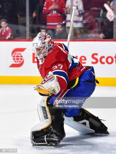 Antti Niemi of the Montreal Canadiens gloves the puck during the warmup prior to the NHL game against the Detroit Red Wings at the Bell Centre on...