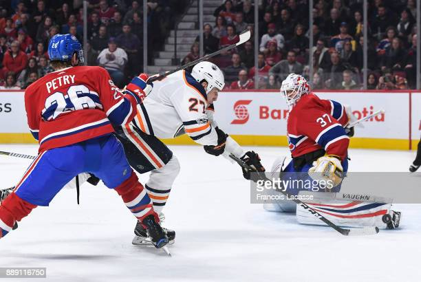 Antti Niemi of the Montreal Canadiens makes a foot save against Milan Lucic of the Edmonton Oilers in the NHL game at the Bell Centre on December 9...
