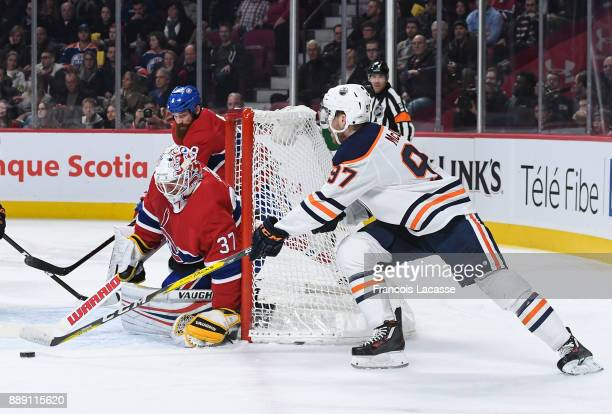 Antti Niemi of the Montreal Canadiens makes a save against Connor McDavid of the Edmonton Oilers in the NHL game at the Bell Centre on December 9...