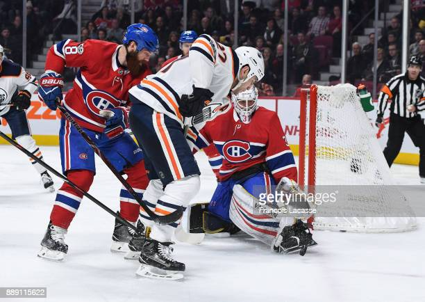 Antti Niemi of the Montreal Canadiens makes a save in front of Milan Lucic of the Edmonton Oilers in the NHL game at the Bell Centre on December 9...