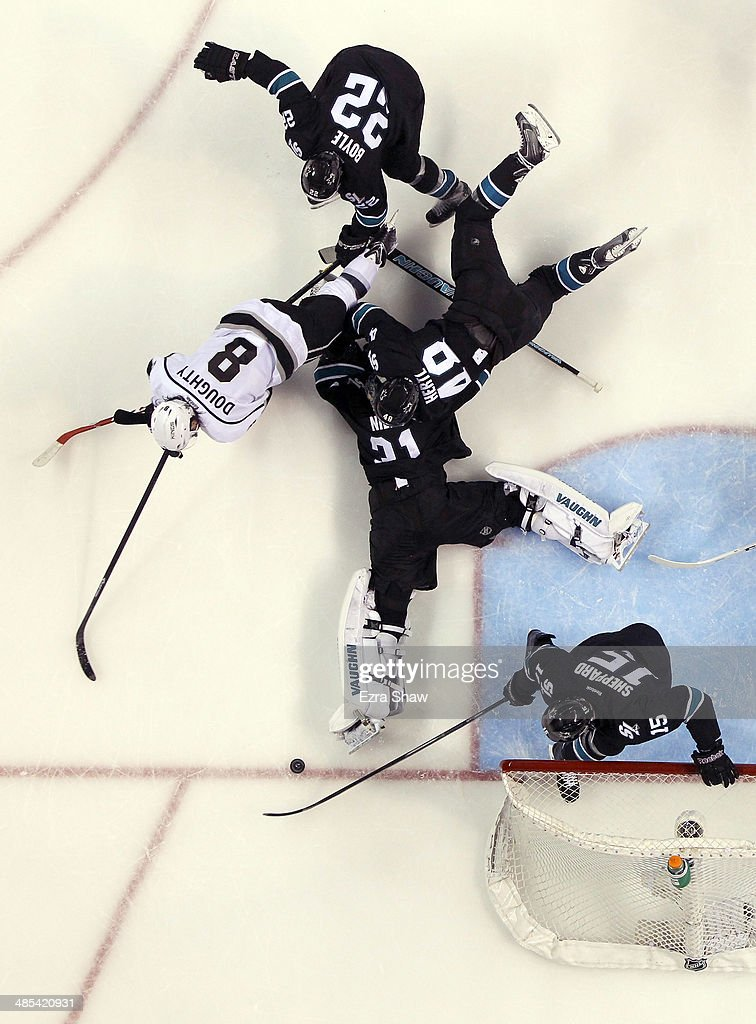<a gi-track='captionPersonalityLinkClicked' href=/galleries/search?phrase=Antti+Niemi&family=editorial&specificpeople=213913 ng-click='$event.stopPropagation()'>Antti Niemi</a> #31 of the San Jose Sharks and the defense stop Drew Doughty #8 of the Los Angeles Kings from scoring in the third period in Game One of the First Round of the 2014 NHL Stanley Cup Playoffs at SAP Center on April 17, 2014 in San Jose, California.