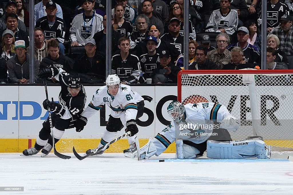 <a gi-track='captionPersonalityLinkClicked' href=/galleries/search?phrase=Antti+Niemi&family=editorial&specificpeople=213913 ng-click='$event.stopPropagation()'>Antti Niemi</a> #31 of the San Jose Sharks blocks a shot on goal by <a gi-track='captionPersonalityLinkClicked' href=/galleries/search?phrase=Marian+Gaborik&family=editorial&specificpeople=202477 ng-click='$event.stopPropagation()'>Marian Gaborik</a> #12 of the Los Angeles Kings in Game Three of the First Round of the 2014 Stanley Cup Playoffs at Staples Center on April 22, 2014 in Los Angeles, California.