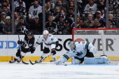Antti Niemi of the San Jose Sharks blocks a shot on goal by Marian Gaborik of the Los Angeles Kings in Game Three of the First Round of the 2014...