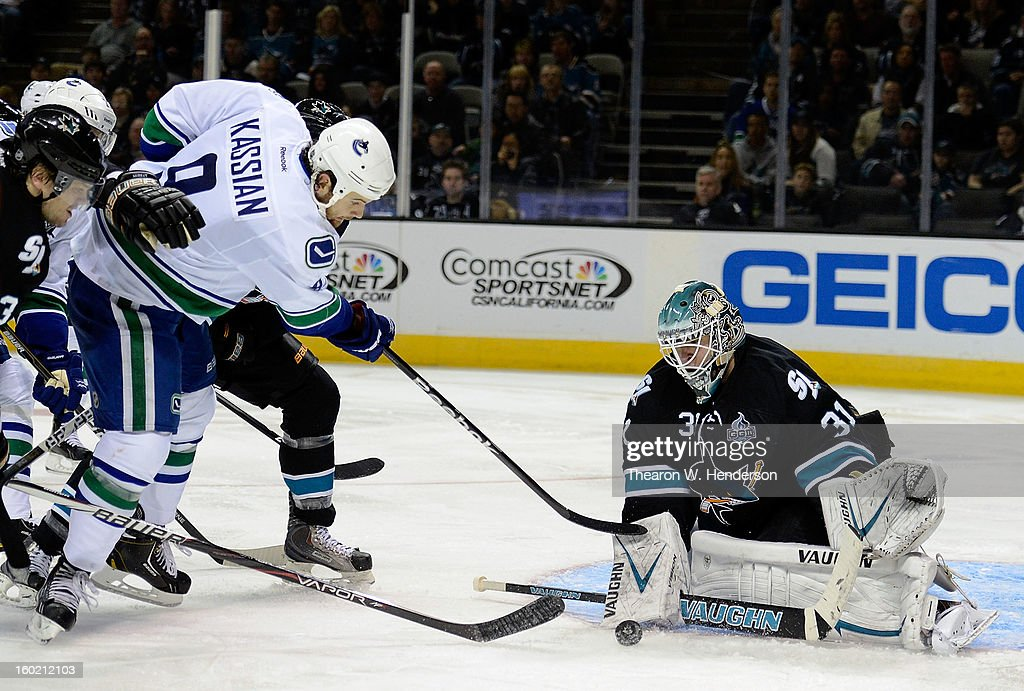 Antti Niemi #31 of the San Jose Sharks blocks the shot of Zack Kassian #9 of the Vancouver Canucks in the third period of their game at HP Pavilion on January 27, 2013 in San Jose, California. The Sharks won the game 4-1.