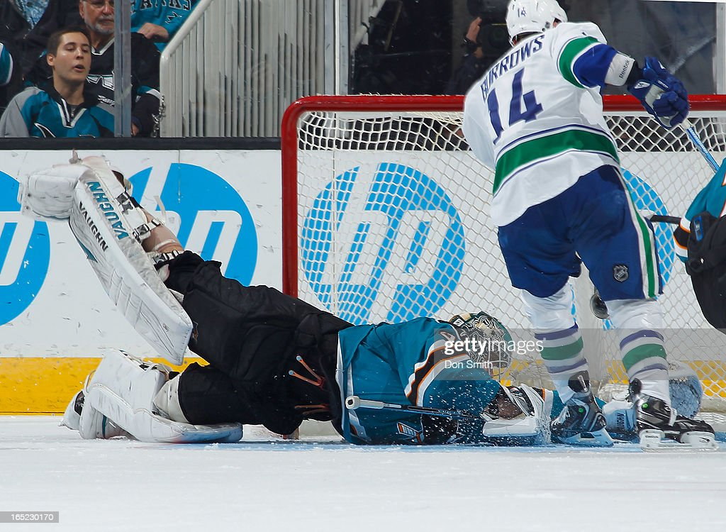 <a gi-track='captionPersonalityLinkClicked' href=/galleries/search?phrase=Antti+Niemi&family=editorial&specificpeople=213913 ng-click='$event.stopPropagation()'>Antti Niemi</a> #31 of the San Jose Sharks can't stop a goal against <a gi-track='captionPersonalityLinkClicked' href=/galleries/search?phrase=Alexandre+Burrows&family=editorial&specificpeople=592489 ng-click='$event.stopPropagation()'>Alexandre Burrows</a> #14 of the Vancouver Canucks during an NHL game on April 1, 2013 at HP Pavilion in San Jose, California.