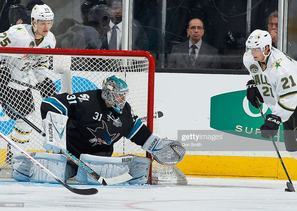 <a gi-track='captionPersonalityLinkClicked' href=/galleries/search?phrase=Antti+Niemi&family=editorial&specificpeople=213913 ng-click='$event.stopPropagation()'>Antti Niemi</a> #31 of the San Jose Sharks defends the net against <a gi-track='captionPersonalityLinkClicked' href=/galleries/search?phrase=Loui+Eriksson&family=editorial&specificpeople=2235241 ng-click='$event.stopPropagation()'>Loui Eriksson</a> #21 of the Dallas Stars during an NHL game on April 7, 2013 at HP Pavilion in San Jose, California.