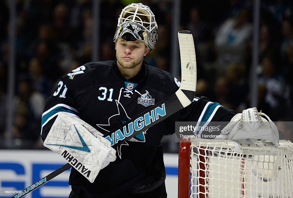 Antti Niemi #31 of the San Jose Sharks looks on during a break in the action against the Vancouver Canucks at HP Pavilion on January 27, 2013 in San Jose, California.