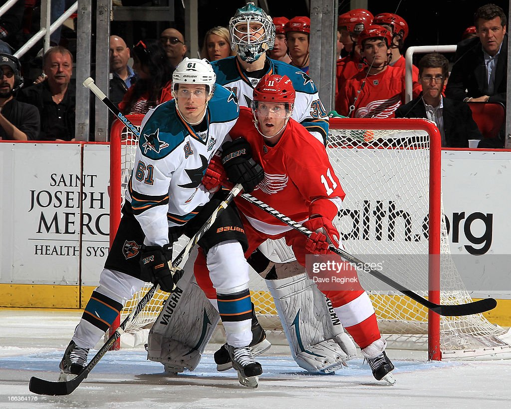 <a gi-track='captionPersonalityLinkClicked' href=/galleries/search?phrase=Antti+Niemi&family=editorial&specificpeople=213913 ng-click='$event.stopPropagation()'>Antti Niemi</a> #31 of the San Jose Sharks looks over teamate Justin Braun #61 as he battle with <a gi-track='captionPersonalityLinkClicked' href=/galleries/search?phrase=Daniel+Cleary&family=editorial&specificpeople=220490 ng-click='$event.stopPropagation()'>Daniel Cleary</a> #11 of the Detroit Red Wings in the front of the net during a NHL game at Joe Louis Arena on April 11, 2013 in Detroit, Michigan. San Jose defeated Detroit 3-2 in a shoot-out