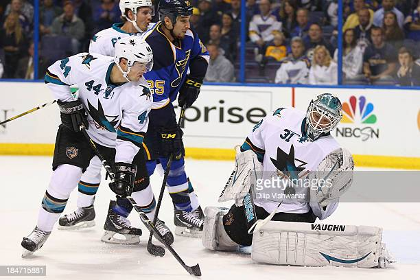 Antti Niemi of the San Jose Sharks makes a save against Chris Stewart of the St Louis Blues as MarcEdouard Vlasic of the Sharks defends at the...