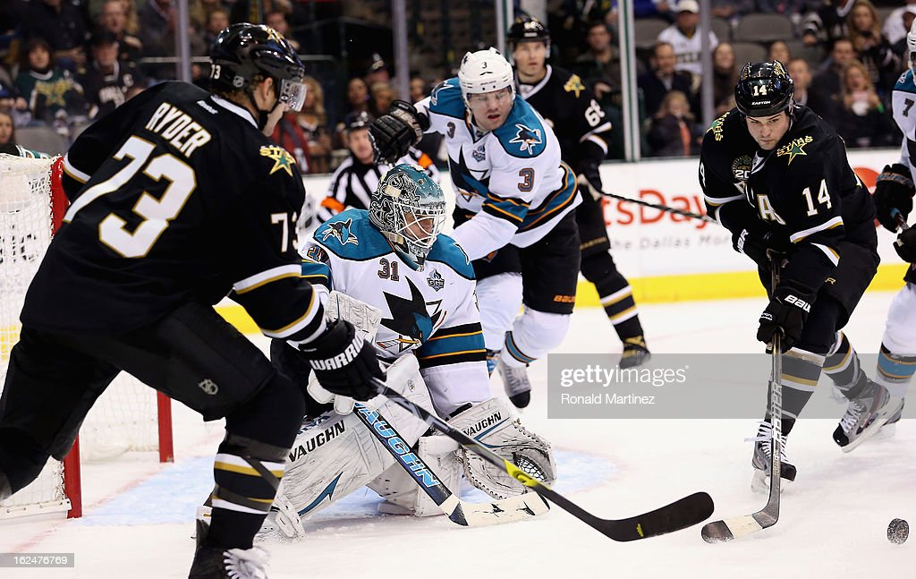 <a gi-track='captionPersonalityLinkClicked' href=/galleries/search?phrase=Antti+Niemi&family=editorial&specificpeople=213913 ng-click='$event.stopPropagation()'>Antti Niemi</a> #31 of the San Jose Sharks makes a save against <a gi-track='captionPersonalityLinkClicked' href=/galleries/search?phrase=Jamie+Benn&family=editorial&specificpeople=4595070 ng-click='$event.stopPropagation()'>Jamie Benn</a> #14 of the Dallas Stars at American Airlines Center on February 23, 2013 in Dallas, Texas.