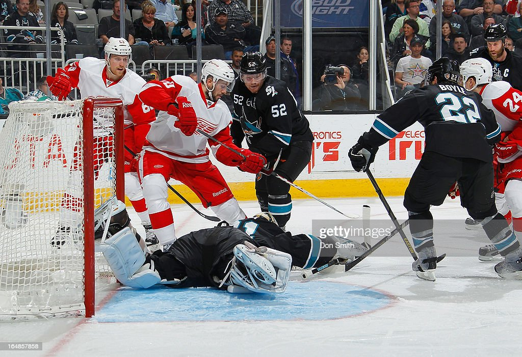 <a gi-track='captionPersonalityLinkClicked' href=/galleries/search?phrase=Antti+Niemi&family=editorial&specificpeople=213913 ng-click='$event.stopPropagation()'>Antti Niemi</a> #31 of the San Jose Sharks makes a save against members of the Detroit Red Wings during an NHL game on March 28, 2013 at HP Pavilion in San Jose, California.
