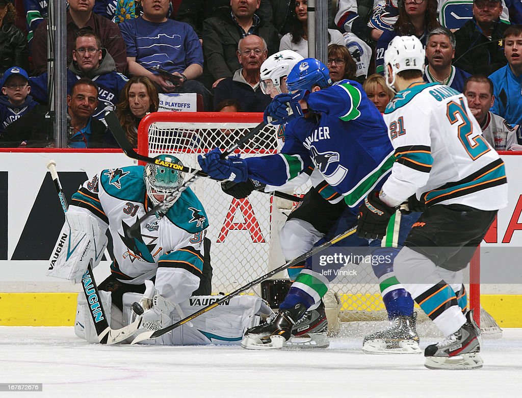 <a gi-track='captionPersonalityLinkClicked' href=/galleries/search?phrase=Antti+Niemi&family=editorial&specificpeople=213913 ng-click='$event.stopPropagation()'>Antti Niemi</a> #31 of the San Jose Sharks makes a save under pressure from <a gi-track='captionPersonalityLinkClicked' href=/galleries/search?phrase=Ryan+Kesler&family=editorial&specificpeople=206915 ng-click='$event.stopPropagation()'>Ryan Kesler</a> #17 of the Vancouver Canucks during Game One of the Western Conference Quarterfinals during the 2013 NHL Stanley Cup Playoffs at Rogers Arena on May 1, 2013 in Vancouver, British Columbia, Canada. San Jose won 3-1.