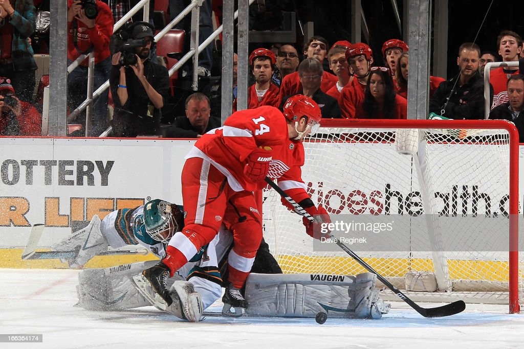 <a gi-track='captionPersonalityLinkClicked' href=/galleries/search?phrase=Antti+Niemi&family=editorial&specificpeople=213913 ng-click='$event.stopPropagation()'>Antti Niemi</a> #31 of the San Jose Sharks makes an amazing toe save in on a shoot-out attempt by Gustav Nyquist #14 of the Detroit Red Wings during a NHL game at Joe Louis Arena on April 11, 2013 in Detroit, Michigan. San Jose defeated Detroit 3-2 in a shoot-out