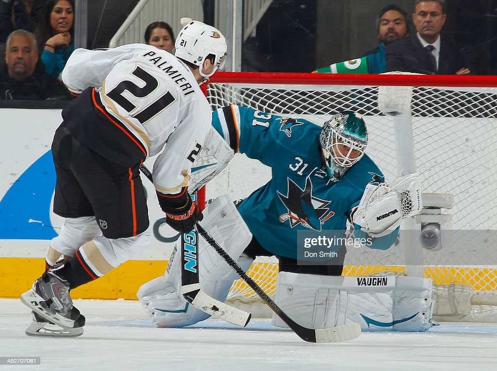 <a gi-track='captionPersonalityLinkClicked' href=/galleries/search?phrase=Antti+Niemi&family=editorial&specificpeople=213913 ng-click='$event.stopPropagation()'>Antti Niemi</a> #31 of the San Jose Sharks makes the game winning save in the shootout against <a gi-track='captionPersonalityLinkClicked' href=/galleries/search?phrase=Kyle+Palmieri&family=editorial&specificpeople=4783296 ng-click='$event.stopPropagation()'>Kyle Palmieri</a> #21 of the Anaheim Ducks during an NHL game on November 30, 2013 at SAP Center in San Jose, California.