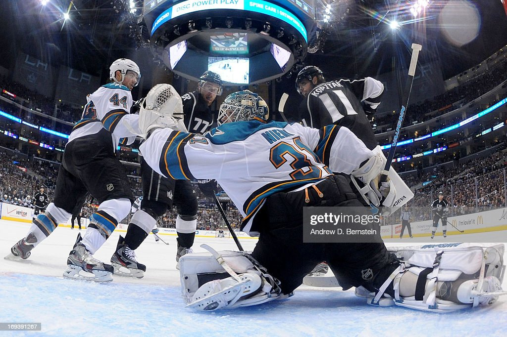 <a gi-track='captionPersonalityLinkClicked' href=/galleries/search?phrase=Antti+Niemi&family=editorial&specificpeople=213913 ng-click='$event.stopPropagation()'>Antti Niemi</a> #31 of the San Jose Sharks makes the save against the Los Angeles Kings in Game Five of the Western Conference Semifinals during the 2013 NHL Stanley Cup Playoffs at Staples Center on May 23, 2013 in Los Angeles, California.