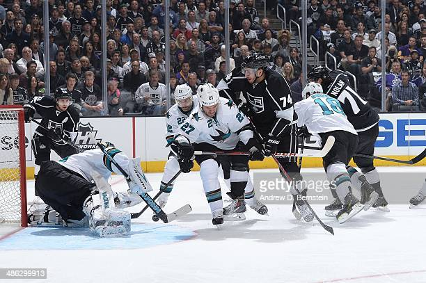 Antti Niemi of the San Jose Sharks protects the goal against a shot from Dwight King of the Los Angeles Kings in Game Three of the First Round of the...