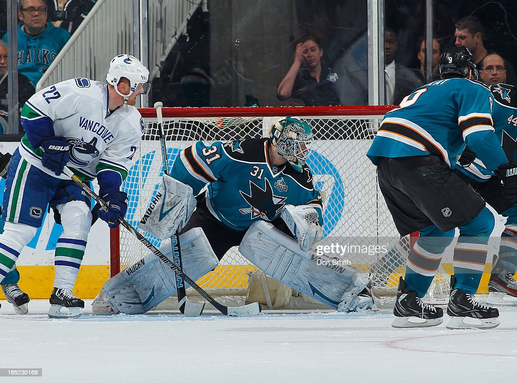 <a gi-track='captionPersonalityLinkClicked' href=/galleries/search?phrase=Antti+Niemi&family=editorial&specificpeople=213913 ng-click='$event.stopPropagation()'>Antti Niemi</a> #31 of the San Jose Sharks protects the net against <a gi-track='captionPersonalityLinkClicked' href=/galleries/search?phrase=Daniel+Sedin&family=editorial&specificpeople=202492 ng-click='$event.stopPropagation()'>Daniel Sedin</a> #22 of the Vancouver Canucks during an NHL game on April 1, 2013 at HP Pavilion in San Jose, California.