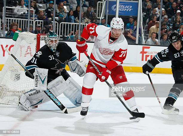 Antti Niemi of the San Jose Sharks protects the net against Daniel Cleary of the Detroit Red Wings during an NHL game on January 9 2014 at SAP Center...