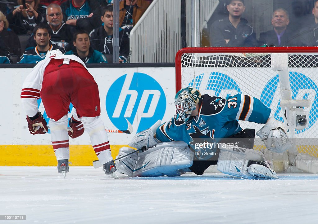 <a gi-track='captionPersonalityLinkClicked' href=/galleries/search?phrase=Antti+Niemi&family=editorial&specificpeople=213913 ng-click='$event.stopPropagation()'>Antti Niemi</a> #31 of the San Jose Sharks saves a shoot out shot against <a gi-track='captionPersonalityLinkClicked' href=/galleries/search?phrase=Radim+Vrbata&family=editorial&specificpeople=204716 ng-click='$event.stopPropagation()'>Radim Vrbata</a> #17 of the Phoenix Coyotes during an NHL game on March 30, 2013 at HP Pavilion in San Jose, California.
