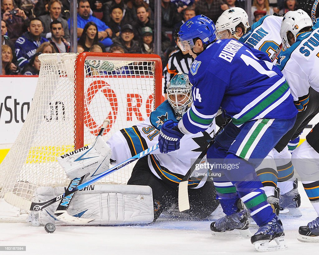 <a gi-track='captionPersonalityLinkClicked' href=/galleries/search?phrase=Antti+Niemi&family=editorial&specificpeople=213913 ng-click='$event.stopPropagation()'>Antti Niemi</a> #31 of the San Jose Sharks stops the shot of <a gi-track='captionPersonalityLinkClicked' href=/galleries/search?phrase=Alexandre+Burrows&family=editorial&specificpeople=592489 ng-click='$event.stopPropagation()'>Alexandre Burrows</a> #14 of the Vancouver Canucks during an NHL game at Rogers Arena on March 5, 2013 in Vancouver, British Columbia, Canada.
