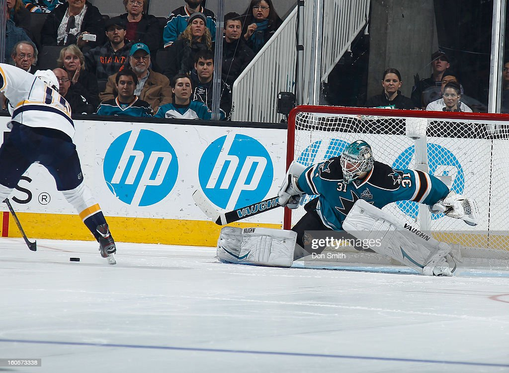 Antti Niemi #31 of the San Jose Sharks stretches out to try to make a save against David Legwand #11 of the Nashville Predators during an NHL game on February 2, 2013 at HP Pavilion in San Jose, California.