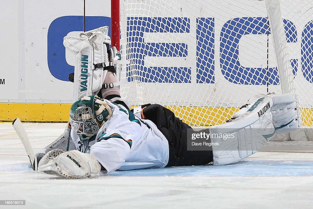 <a gi-track='captionPersonalityLinkClicked' href=/galleries/search?phrase=Antti+Niemi&family=editorial&specificpeople=213913 ng-click='$event.stopPropagation()'>Antti Niemi</a> #31 of the San Jose Sharks throw up his leg and stops a shoot-out attempt by Todd Bertuzzi #44 of the Detroit Red Wings (not pictured) during an NHL game at Joe Louis Arena on October 21, 2013 in Detroit, Michigan.