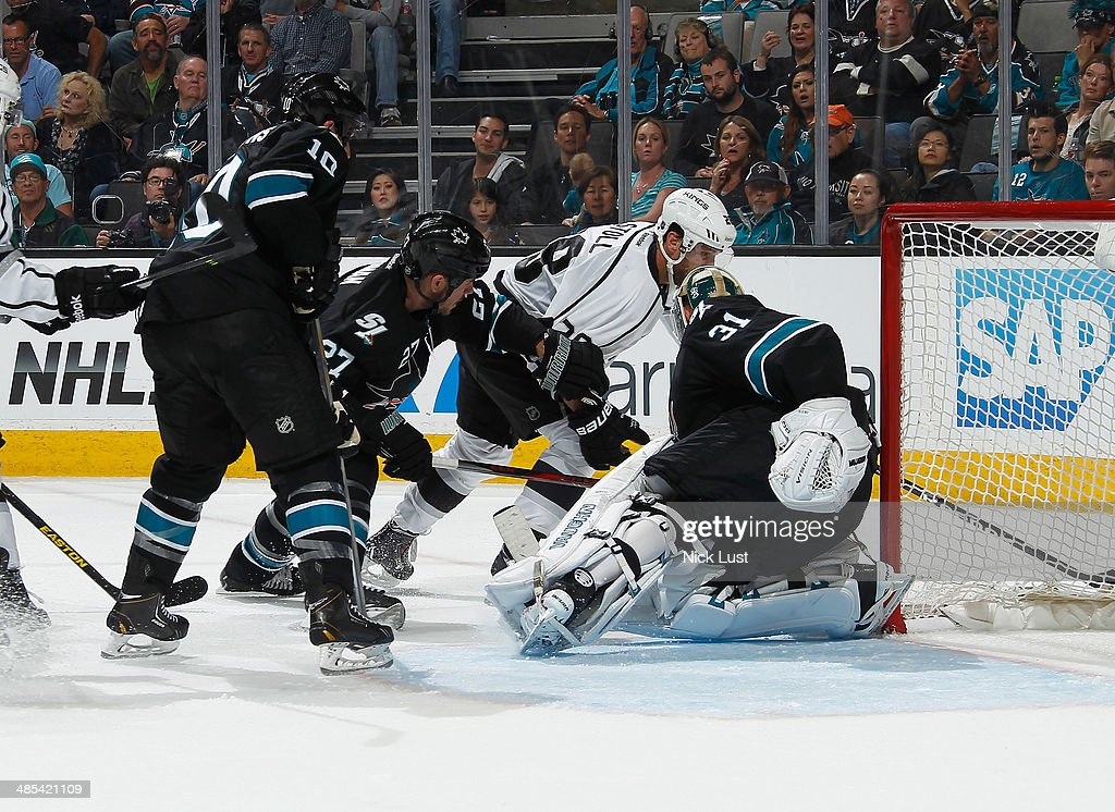 <a gi-track='captionPersonalityLinkClicked' href=/galleries/search?phrase=Antti+Niemi&family=editorial&specificpeople=213913 ng-click='$event.stopPropagation()'>Antti Niemi</a> #31, <a gi-track='captionPersonalityLinkClicked' href=/galleries/search?phrase=Scott+Hannan&family=editorial&specificpeople=203195 ng-click='$event.stopPropagation()'>Scott Hannan</a> #27 and <a gi-track='captionPersonalityLinkClicked' href=/galleries/search?phrase=Andrew+Desjardins&family=editorial&specificpeople=2748431 ng-click='$event.stopPropagation()'>Andrew Desjardins</a> #10 of the San Jose Sharks protect the net against <a gi-track='captionPersonalityLinkClicked' href=/galleries/search?phrase=Jarret+Stoll&family=editorial&specificpeople=204632 ng-click='$event.stopPropagation()'>Jarret Stoll</a> #28 of the Los Angeles Kings in Game One of the First Round of the 2014 Stanley Cup Playoffs at SAP Center on April 17, 2014 in San Jose, California.