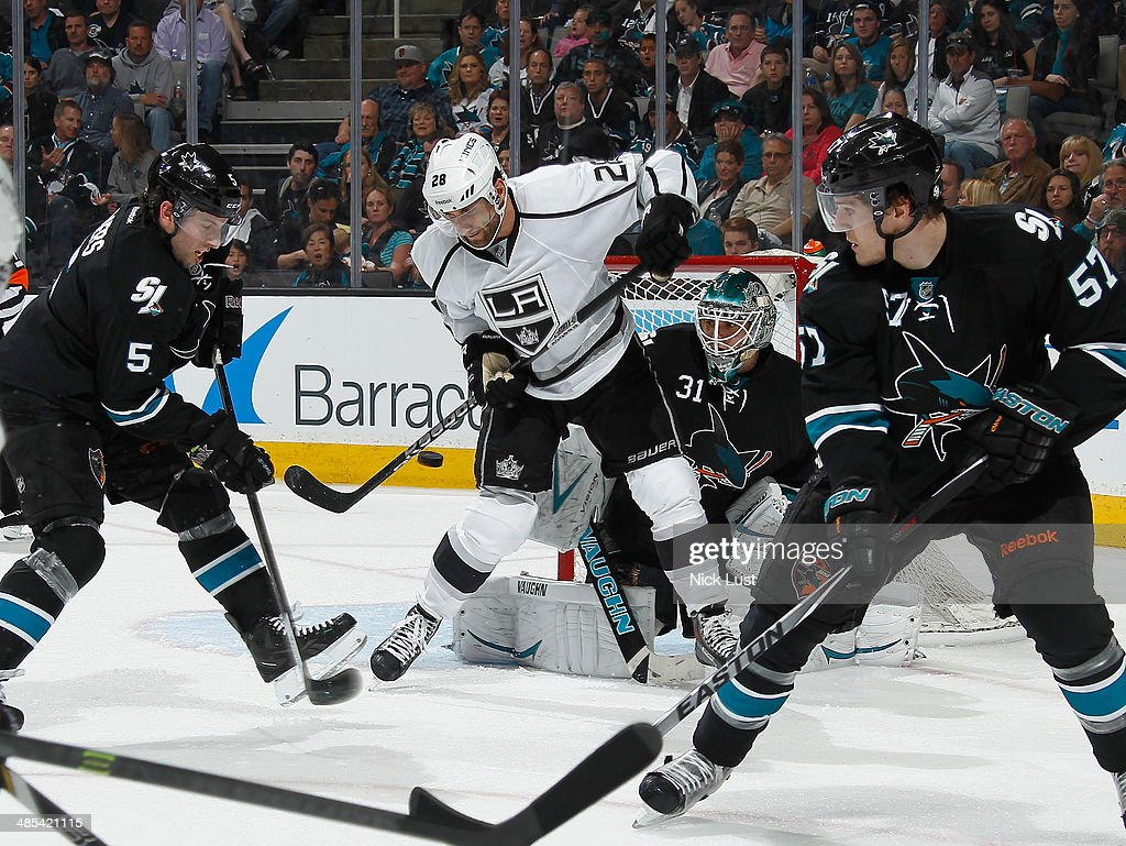 <a gi-track='captionPersonalityLinkClicked' href=/galleries/search?phrase=Antti+Niemi&family=editorial&specificpeople=213913 ng-click='$event.stopPropagation()'>Antti Niemi</a> #31, <a gi-track='captionPersonalityLinkClicked' href=/galleries/search?phrase=Tommy+Wingels&family=editorial&specificpeople=5807738 ng-click='$event.stopPropagation()'>Tommy Wingels</a> #57 and <a gi-track='captionPersonalityLinkClicked' href=/galleries/search?phrase=Jason+Demers&family=editorial&specificpeople=2282534 ng-click='$event.stopPropagation()'>Jason Demers</a> #5 of the San Jose Sharks protect the net against <a gi-track='captionPersonalityLinkClicked' href=/galleries/search?phrase=Jarret+Stoll&family=editorial&specificpeople=204632 ng-click='$event.stopPropagation()'>Jarret Stoll</a> #28 of the Los Angeles Kings in Game One of the First Round of the 2014 Stanley Cup Playoffs at SAP Center on April 17, 2014 in San Jose, California.
