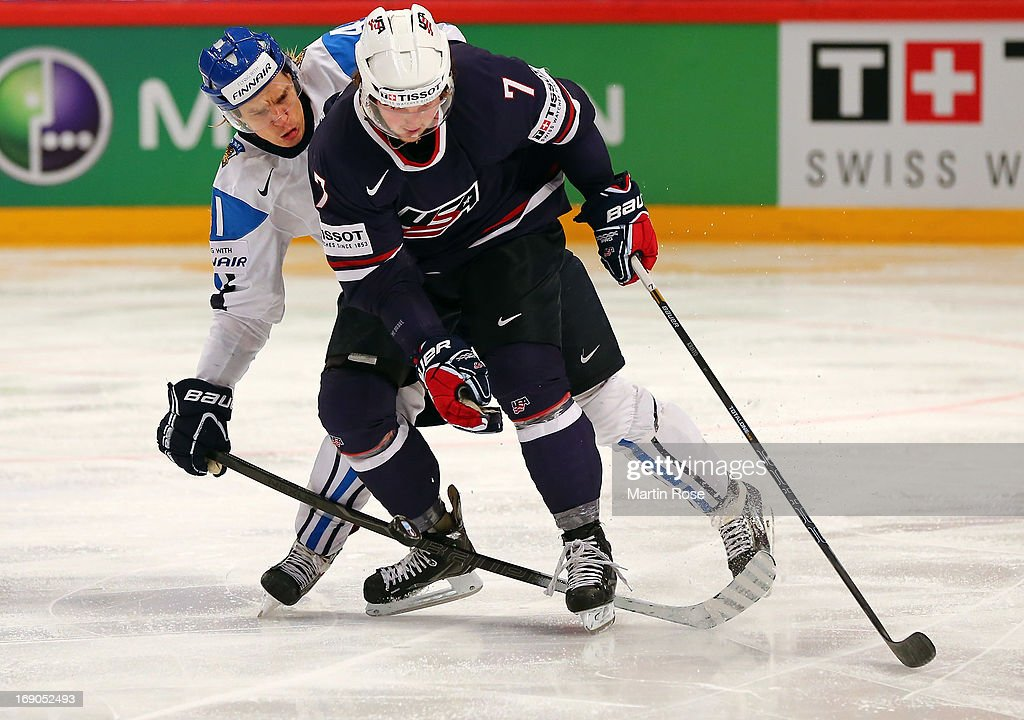 Antti Pihlstrom (L) of Finland and Danny Kristo(R) of USA battle for the puck during the IIHF World Championship third place match between Finland and USA at Globen Arena on May 19, 2013 in Stockholm, Sweden.