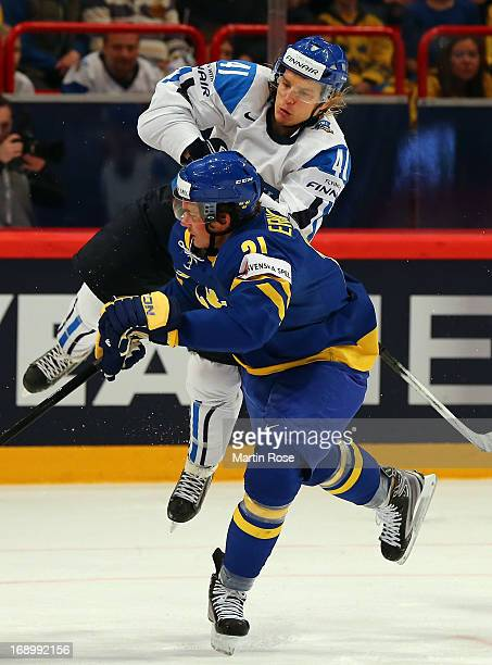 Antti Pihlstrom of Finland and Loui Eriksson of Sweden battle for the puck during the IIHF World Championship semifinal match between Finland and...
