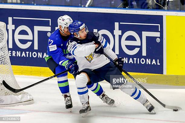Antti Pihlstrom of Finland and Marcel Rodman of Slovenia battle for the puck during the IIHF World Championship group B match between Finland and...