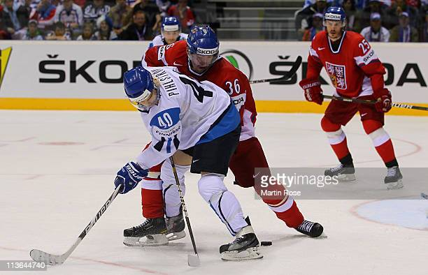 Antti Pihlstrom of Finland and Petr Caslava of Czech Republic battle for the puck during the IIHF World Championship group D match between Finland...