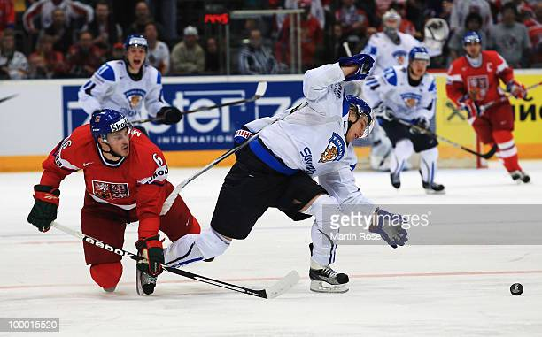 Antti Pihlstrom of Finland and Tomas Mojzis of Czech Republic battle for the puck during the IIHF World Championship quarter final match between...