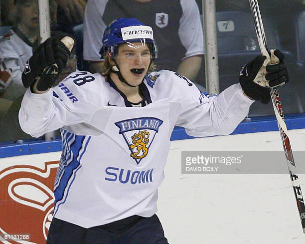 Antti Pihlstrom of Finland celebrates after scoring Finland's third goal for a 30 lead over Sweden in the third period during the bronze medal game...