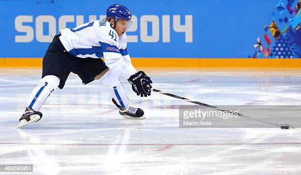 Antti Pihlstrom of Finland handles the puck against Norway during the Men's Ice Hockey Preliminary Round Group B game on day seven of the Sochi 2014...