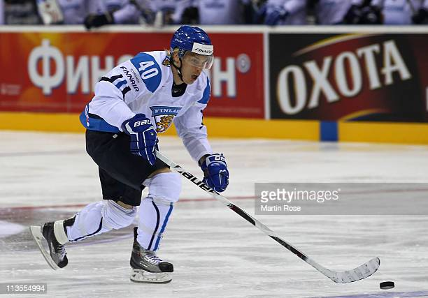 Antti Pihlstrom of Finland skate with the puck during the IIHF World Championship group D match between Latvia and Finland at Orange Arena on May 2...