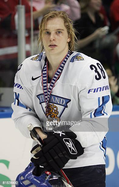 Antti Pihlstrom of Finland skates off the ice with his bronze medal after his teams win against Sweden during the Bronze Medal Game of the...