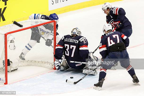Antti Pihlstrom of Finland tries to score against Connor Hellebuyck goalkeeper of the United States during the IIHF World Championship group B match...