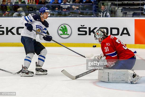 Antti Pihlstrom of Finland tries to score against Lars Volden goalkeeper of Norway during the IIHF World Championship group B match between Norway...