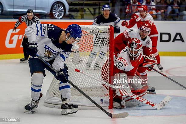 Antti Pihlstrom of Finland tries to score against Sebastian Dahm goalkeeper of Denmark during the IIHF World Championship group B match between...