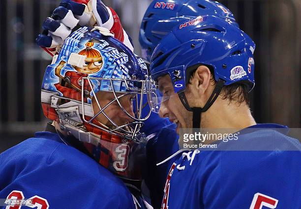 Antti Raanta and Dan Girardi of the New York Rangers celebrate their 40 victory over the San Jose Sharks at Madison Square Garden on October 19 2015...