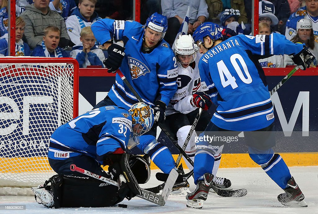 Antti Raanta (#32), goaltender of Finland makes a save on Craig Smith (C) of USA during the IIHF World Championship group H match between USA and Finland at Hartwall Areena on May 8, 2013 in Helsinki, Finland.