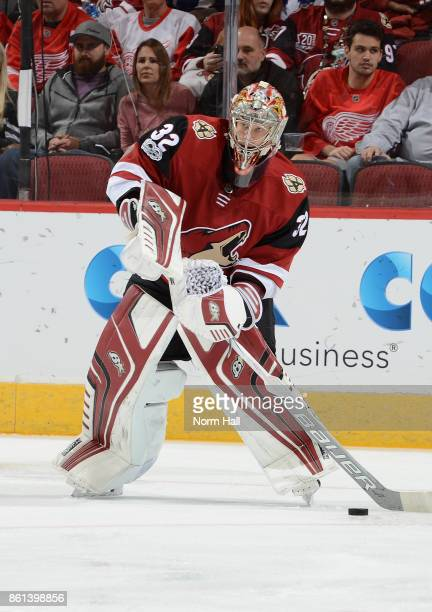 Antti Raanta of the Arizona Coyotes looks to pass the puck against the Detroit Red Wings at Gila River Arena on October 12 2017 in Glendale Arizona