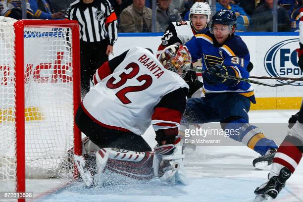 Antti Raanta of the Arizona Coyotes makes a save against Vladimir Tarasenko of the St Louis Blues at Scottrade Center on November 9 2017 in St Louis...