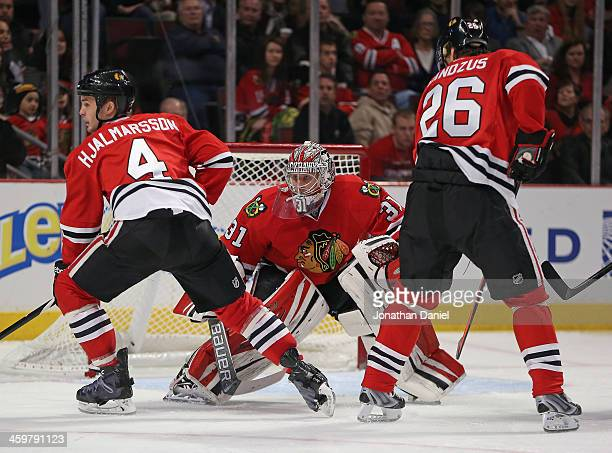 Antti Raanta of the Chicago Blackhawks follows the puck on his way to his first career shutout as teammates Niklas Hjalmarsson and Michal Handzus...