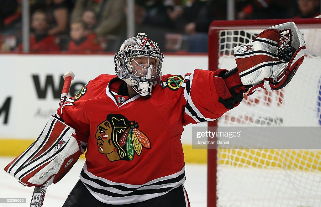 <a gi-track='captionPersonalityLinkClicked' href=/galleries/search?phrase=Antti+Raanta&family=editorial&specificpeople=10892297 ng-click='$event.stopPropagation()'>Antti Raanta</a> #31 of the Chicago Blackhawks makes a glove save against the Arizona Coyotes at the United Center on February 9, 2015 in Chicago, Illinois.