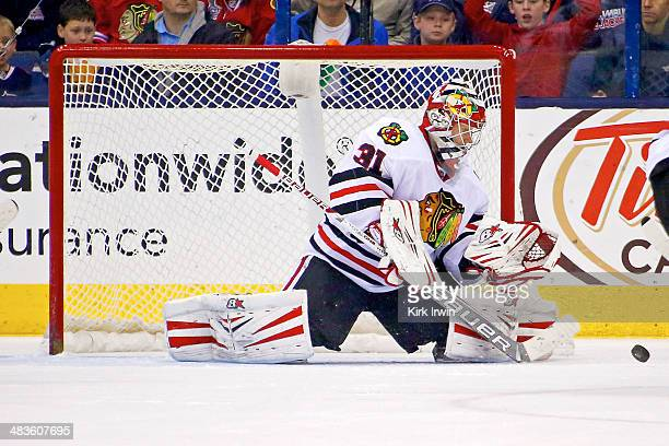 Antti Raanta of the Chicago Blackhawks makes a save during the game against the Columbus Blue Jackets on April 4 2014 at Nationwide Arena in Columbus...
