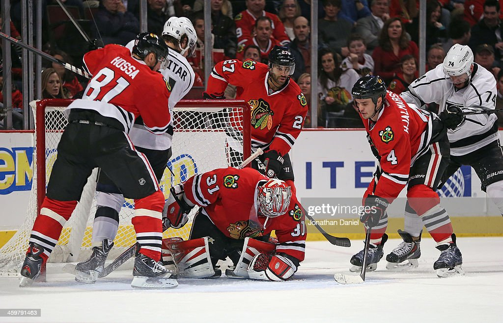 Antti Raanta #31 of the Chicago Blackhawks makes a save his way to his first career shutout against <a gi-track='captionPersonalityLinkClicked' href=/galleries/search?phrase=Anze+Kopitar&family=editorial&specificpeople=634911 ng-click='$event.stopPropagation()'>Anze Kopitar</a> #11 of the Los Angeles Kings as <a gi-track='captionPersonalityLinkClicked' href=/galleries/search?phrase=Marian+Hossa&family=editorial&specificpeople=202233 ng-click='$event.stopPropagation()'>Marian Hossa</a> #81 and <a gi-track='captionPersonalityLinkClicked' href=/galleries/search?phrase=Niklas+Hjalmarsson&family=editorial&specificpeople=2006442 ng-click='$event.stopPropagation()'>Niklas Hjalmarsson</a> #4 defend at the United Center on December 30, 2013 in Chicago, Illinois. The Blackhawks defeated the Kings 1-0.